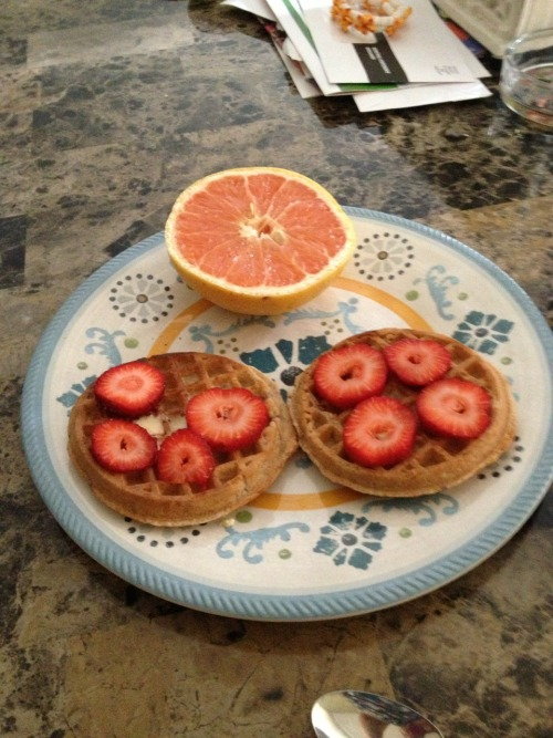 Breakfast today! Whole wheat waffles with earth balance and strawberries and half a grapefruit :)