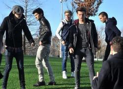 ** One Direction in the middle of shooting a music video, looking ridiculously beautiful and fresh to death.   Go ahead - stop and stare at this ridiculously good looking band.  I'm loving the news boy cap and leather jacket that my fav (styling and profiling) Harry Styles is rocking. He looks incredible! Usually men who wear their pants that low annoy the hell out of me - but with Zayn I allow it (because he looks so good).  I'm forever at war with myself as to whether I'm a fan of Liam's buzz cut or not; sometimes I love it, and other times I wish it was a short flick again. In the picture(s) above I'm very much a fan.  Naill looks great; his pants fit him right, he's rocking those chunky white sneaks, and his jacket fits him nicely. I wish he'd look like this all the time - though I'm pretty sure this is a photo or video shoot  King Louis you're so fine, you blow my mind… ::cough:; Louis sure knows how to wear a pair of jeans…. —————————— **With the people of Newton still in my heart, I must return to regular programming.Out of respect for my fellow Fairfield Country natives I would never post photos of the victims, nor would I ever put a face (or name) pictures of the assailant here. I hope all our lost children and school staff are resting in peace; I'll be thinking of the victims and their families over this holiday season.
