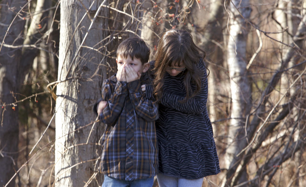 theatlantic:  Young children stand outside Sandy Hook Elementary School after the shooting in Newtown, Connecticut. [Image: Michelle McLoughlin/Reuters]  Oh, jesus.
