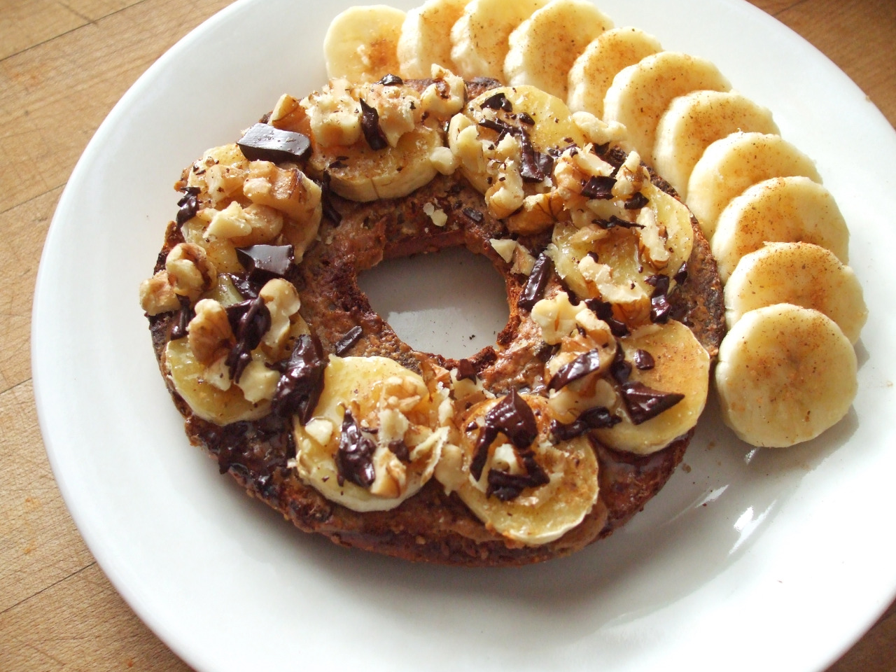 garden-of-vegan:  broiled whole grain bagel with almond butter, banana, cinnamon, maple syrup, walnuts, and dark chocolate