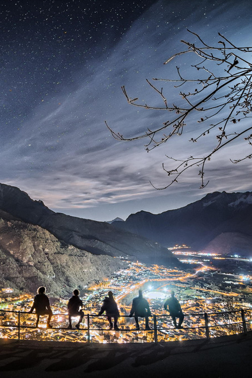 Guys above the city of Chiavenna, Italy  by Jacopo M