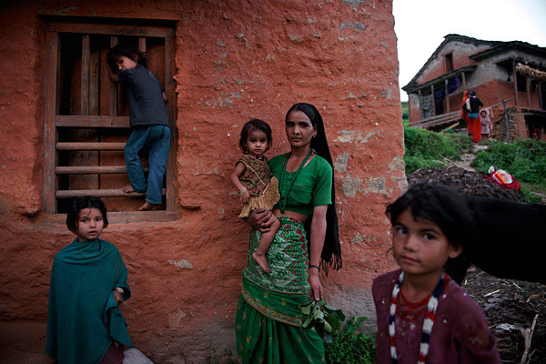 unicef:  PHOTO OF THE WEEK: 14 May 2013Poverty reductions in Nepal have accompanied significant gains in child nutrition. But the poorest children, who have the least access to vital services, remain most vulnerable to nutritional deficiencies. Jamuna Saud, her family's sole provider since the death of her husband, works all day in the fields to feed and support her children in Biraltoli Village. A joint UNICEF/EU programme is providing nutrition screenings for children in the impoverished village. ©UNICEF/Shehzad Noorani To see more: www.unicef.org/photography