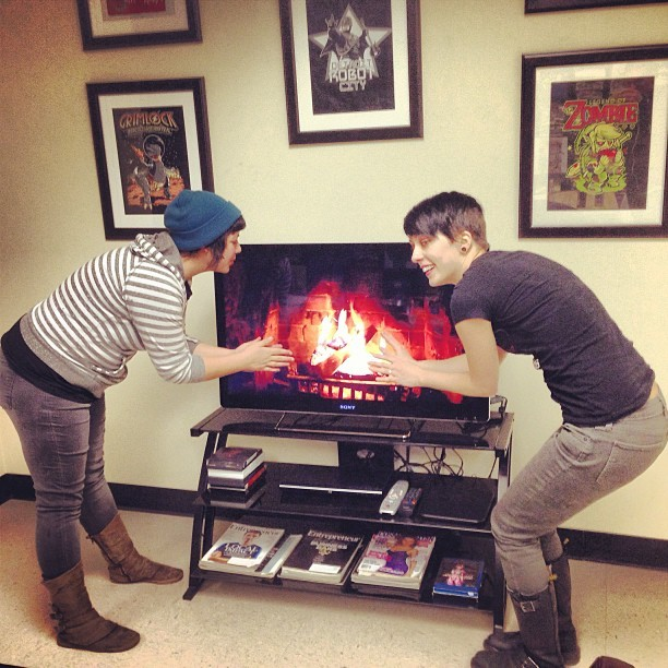 Whitney and Ashley are warming up by the fire trying to keep Chicago weather at bay!