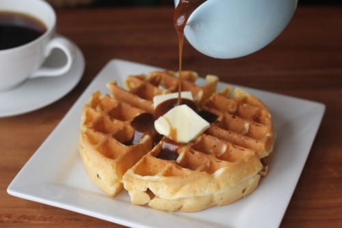 prettygirlfood:  Old Fashioned Waffles with Maple Butterscotch Syrup For the Waffles 2 cups cake flour 2 tsp baking powder 1/2 tsp kosher salt 3 eggs, seperated 1 1/4 cups milk 5 tbsp melted butter Sift the cake flour with the baking powder into a large bowl.  Add the salt and mix.  Beat the egg yolks until they are light and lemon-colored and combine them with the milk and melted butter.  Blend thoroughly and add to the dry ingredients, beating briskly.  Beat egg whites to stiff peaks, but not dry, and gently fold them into the mixture.  Pour the batter from a pitcher or a ladle onto a heated waffle iron, filling the iron only 2/3 full, and let it spread until the whole iron is covered.  Cook until the waffle is puffed and golden-brown.  Life the waffle from the iron with a fork.   For the Maple Butterscotch Syrup  1 cup dark brown sugar 1/3 cup butter 1/3 cup heavy cream 1 tsp maple flavoring 1/2 cup water In a saucepan over medium high heat, mix dark brown sugar, butter, cream, and maple flavoring.  Bring to a boil for 5 minutes without stirring.  Remove the sauce from the heat and add the water, beating for 30 seconds.  Serve warm.