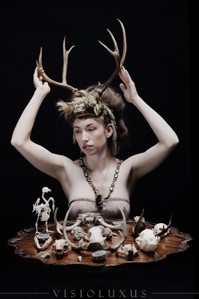The Bone Merchant Model: Verronica Mind blowing hair/MU: Gina Campbell Table from Something Borrowed She has a little fox foot hanging around her neck.