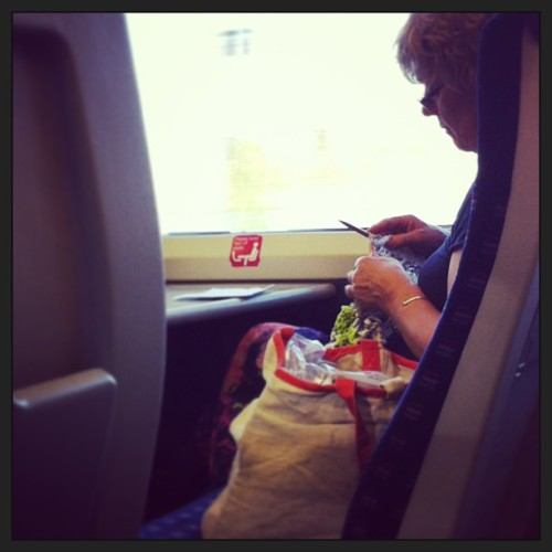 Woman casually knitting with strips of carrier bags on the train back to cambs #knitting #recycle #train #cambridge