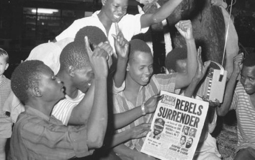 Nigerians in the capital city of Lagos cheer as they read of the surrender of the Biafran forces, Jan. 12, 1970.Vintage Nigeria