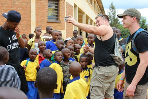 Playing with a group of school kids in Rwanda