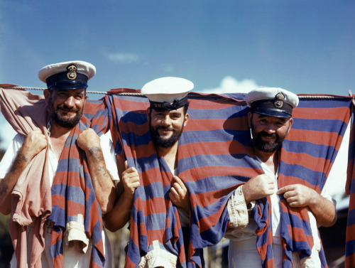 natgeofound:  Three British sailors drape themselves with their soccer jerseys in Trinidad, June 1942. Photograph by Luis Marden, National Geographic
