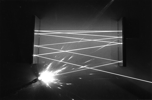 explodingtorium:  Bounced and Scattered Laser Beam Light, photo by Nancy Rodger, 1980