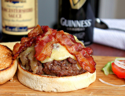 "prettygirlfood:  Guinness Bacon Cheeseburgers 2 lbs ground meat (I actually used a meatloaf mixture of beef, veal and pork, but obviously sirloin would be fine! 80/20)2 Tablespoons Worcestershire Sauce 2 teaspoons Mustard (I used Grey Poupon) 1 teaspoon Garlic Powder 1 teaspoon Onion Powder 1 teaspoon Kosher Salt 1/2 teaspoon fresh cracked Pepper 1/2 teaspoon Liquid Smoke 1/2 teaspoon very finely chopped rosemary (optional and any other herb on hand would do ie: sage, parsley, thyme…) 1/2 cup Guinness1 lb. Freshly cooked baconCreamy Irish Cheddar Cheese for topping (or cheese of choice)Hamburger RollsDirections:Mix all ingredients (minus last 3) together in a large bowl until just incorporated. Do not over work your meat. Form desired sized hamburger patties. I made 6 large ones!  Spray burgers on top with cooking spray to prevent sticking.Preheat your grill to medium. (or cooking pan)Place your burgers cooking spray side down and cook about 6 minutes per side (though cooking time will depend on how thick or thin you formed your patties.) As the burgers cook on the grill, do not press down on them or move them around - rather let them sit there undisturbed, just being careful not to overly, ""char"" the sides.  You're looking for a slower cook as you want the inside of the burger to cook to doneness.  The last 3-4 minutes, place your cheese on top so it has time to melt - cover grill or cooking pan.Remove burgers from gill and allow them to rest about 5 minutes. Place bacon on top and offer additional toppings if desired. EAT WITH A GUINNESS!"