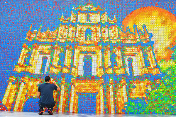 A Rubik's Cube Mural It took Cube Works Studio 85,794 Rubik's Cubes to construct a mural of Macau's skyline. The image is 200 feet long and 13 feet tall and took months to complete. After completion, the experts at the Guiness Book of World Records named it the largest mosaic of its kind. h/t enpundit Ed note: The colors of a Rubik's cube are useless if you're blind. That's why designers have come up with a version that can be solved using only touch.