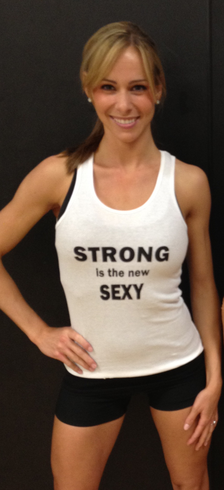 motivatehopestrength:  STRONG IS THE NEW SEXY - American Apparel Tank at: http://hopenagy.com/motivatehopestrength___hope_nagy/Tanks%26Tees.html