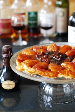Apple tarte tatin, or upside-down caramel apple tart, with strawberries