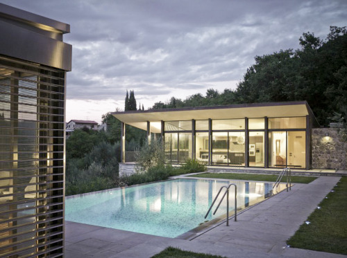 "architizer:  Check Out This Phenomenal Pool House by MDU ARCHITETTI!  ""The place, a lot with a fine view located in the Bisenzio river's valley; the landscape is a sequence of wooded areas, fields, olive-groves. The land is articulated through terraces with stone walls. The project is a silent insertion inside this landscape."" Click through to read more!"