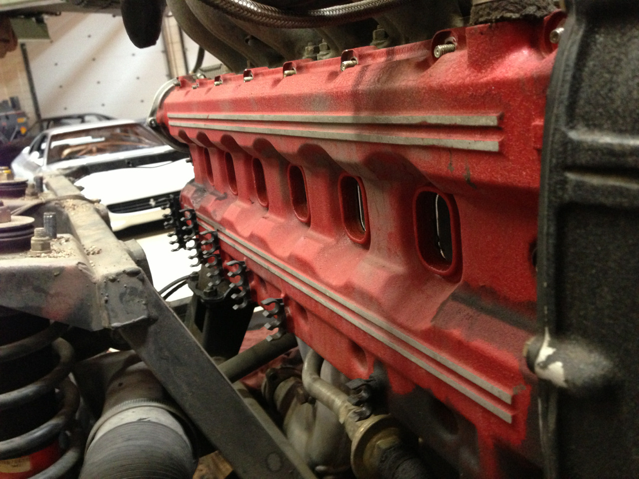 Ferrari flat 12 boxer engine out of a testarossa. Beginning stages of a major service where every seal, belt and hose is replaced with new components.