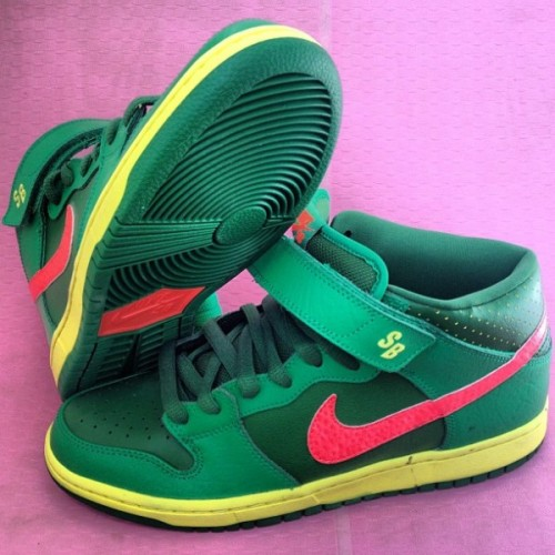 mcfly17:  images have popped up on this new nike sb shoe. there is going to be some heat coming our way this fall. and this refreshing shoe is inspired by a watermelon. it has a green with a green around the nike tip, eyestay and strap. the vamp, tongue, underlay is a darker green. the sidewall is yellow along with the SB logo on the strap. it has yellow polka dots on the underlay and to finish it the shoe has a green outsole with a pink core and swoosh.