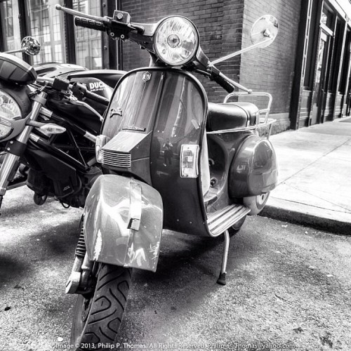 "photosbyphilipthomas:  ""Need a Ride"" In a day and age when has prices are more on the ridiculous side, two-wheel modes of transportation (both motorized and human powered) have become more and more popular in the urban jungle.  The question becomes, ""Where can I park this thing for free?"" #scooter #bike #motorbike #theLoop #financialDistrict #alley #sidewalk #chicago #downtown #igerschicago #citylife #urbanlife #urbandweller. Image © 2013, Philip P Thomas. All rights reserved."