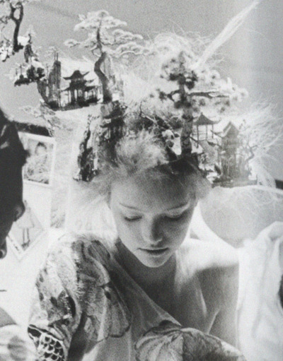 deprincessed:  Memories live forever: Detail of Gemma Ward being helped in to her dress backstage at Alexander McQueen 'It's Only A Game' S/S 2005, shot by Anne Deniau, featured in the book 'Love Looks Not With The Eyes: Thirteen Years with Lee Alexander McQueen'