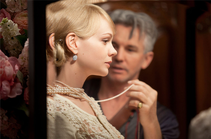 Actress Carey Mulligan and Academy Award®-nominated director Baz Luhrmann on the set of The Great Gatsby. Discover our exclusive jewelry inspired by the film.