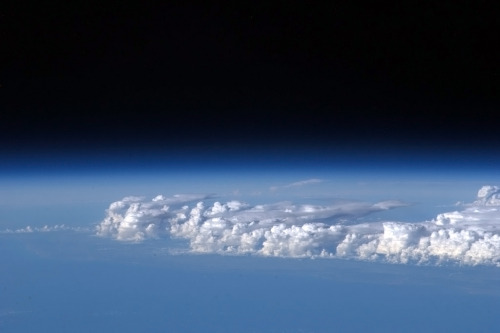 colchrishadfield:  Storm clouds standing tall in the atmosphere over Africa.  Not since Carl Sagan have I got the sense of the pale blue dot so clearly. This guy is humanizing space exploration in such a simple and humble way that we can all get excited about it. Again. I also believe I'll have the chance to get up there in my lifetime.