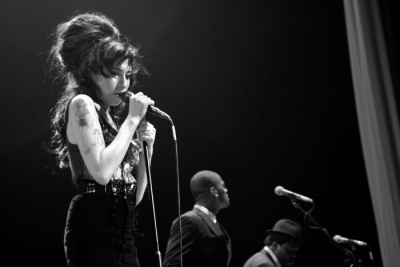 ballion:  Amy Winehouse performing in 2007. Photo by Mattia Zoppellaro.