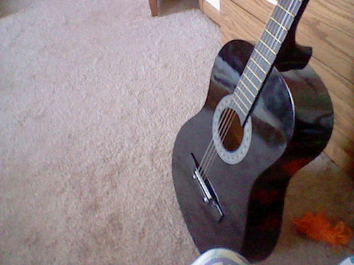 "This is literally my favorite guitar ever. I don't have any other guitars because of this one. I'm already working on two songs with it. I can only hope they weren't already written. They're called ""Falcon"" and ""Wolf Pups"" and my inspiration is Angel Beats' Masami Iwasawa. If anyone's any advice for me, I'll need it!"