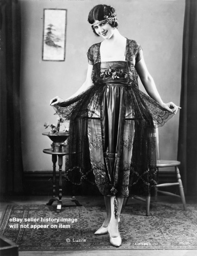kittyinva:   1921 Lucile evening gown of a black chantilly lace hoop over a white satin slip, shown at the National Retail Garment Association Fashion Show at the Hotel Commodore, NYC. From Ebay.