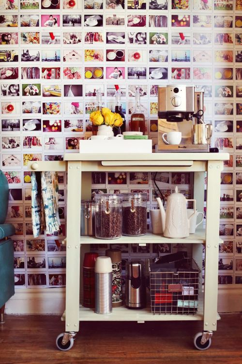 "paris2london:   (via Elsie's ReStyled Espresso Cart - A Beautiful Mess)   As someone with a decidedly ""more is more"" aesthetic, that photo wallpaper is entrancing me. There's a DIY tutorial but it's not that helpful:  My brother helped me design 11x17 inch images with 9 Instax wide sized photos per sheet. We then created 4 different sheets with different photos. You could always do more if you wanted to reduce repeat photos! We measured the wall and ordered about 130 sheets on 80 lb card stock. We found an inexpensive local printer that did them for around $1 per sheet, so the entire wall only cost about $130!  So did she take the photos, scan them, assemble them into a single image using Photoshop, then give that to the printer? I need more details. But anyway, this really inspires me to use up the last 5 or so Polaroid photos on the role of film I've had since 2007-ish—I should at least see if it's still good, and consider buying more."