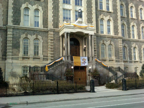 "St. Ignatius College Prep (Chicago) — decorated with papal bunting commemorating the election of Francis, the first Jesuit to become Pope. Photo taken March 17, 2013; courtesy of Ellen  Skerrett.  St. Ignatius College, built in 1870 next to Holy Family church (the ""Prairie Cathedral"") by Fr. Arnold Damen, S.J., eventually became two present-day institutions: St. Ignatius College Prep (in the original location on Chicago's near west side); and Loyola University Chicago (on Chicago's north side)."