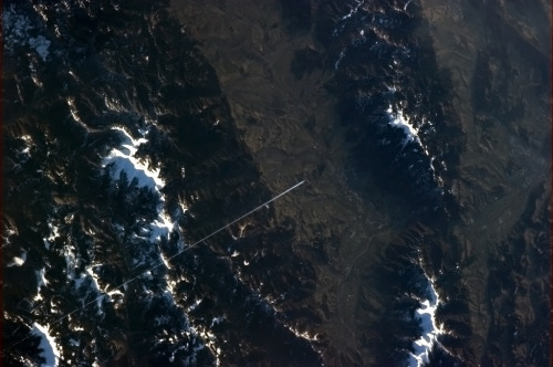colchrishadfield:  A lone jet draws a straight line across the Tatras.