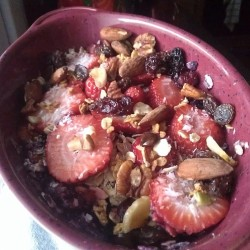 Berry Coconut Oatmeal: Mangos, #blueberries, #strawberries, #coconut, trail mix, oats. #breakfast #vegan #oatmeal #mango #almonds