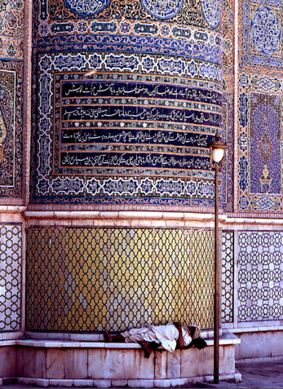 afghanistaninphotos:  A man takes a nap by a lamp post in the Mosque of Herat, East Afghanistan. 1973.  © Hubert Marot