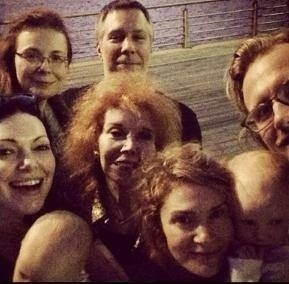 saypussy-again:  Laura's whole family yesterday in NYC. (I see you holding that baby, Laura.)