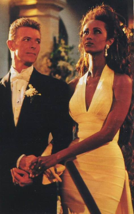 suicideblonde:  rockstarsuits:  Bowie in his wedding tuxedo by Thierry Mugler. (Iman in Herve Leger)  THIS IS EPICCCC