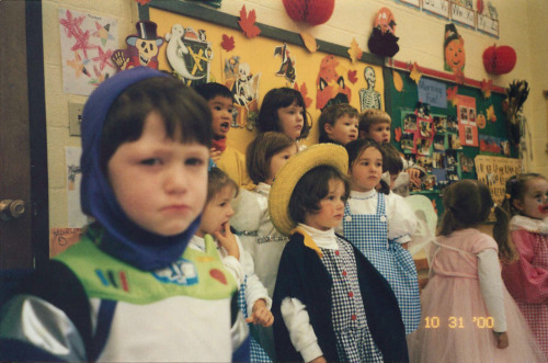 "havocados:   basedgaben:  My dad credits this as his favorite photo of me. When I was younger, I was very socially anxious. I hated crowds, hated attention, hated being up on stage. In preschool there was this little Halloween show that we put on, and man, I did not want to do that shit, let me tell you. All those parents watching me sing some stupid song? Nah, that ain't me. But I was forced to, and I was pissed about it. My dad was in the audience, taking pictures and enjoying the show. In that moment, I swear, my tiny four year old was pure rage and resentment. I felt the word ""fuck"" years before I knew what it was. My dad pointed the camera at me, and I turned, and I looked. I gave him the look that summed up all the anger, all the absolute fury that was brewing inside me. He says that he had never before seen such a perfect depiction of total and complete hatred. In his four year old son. To this day whenever I get pissed, he calls me ""Buzz Lightyear"".  I felt the word ""fuck"" years before I knew what it was."