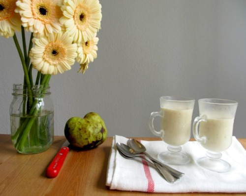 "kcetliving:  Local and Seasonal: Cherimoya Smoothies I'd always been afraid to buy a cherimoya, until I learned of the plant's disarming nickname: ""the ice cream fruit."" (I love ice cream!) Oh sure, its chartreuse color, whopping size, and close resemblance to a prehistoric cactus had intrigued me, but for a long while I lacked the courage to taste one. Newly convinced that there must be something exciting going on below the ice cream fruit's scaly skin, I bought one at the farmers' market, sliced into it, and found exquisitely perfumed pulp. Depending on the variety of cherimoya, the creamy interior can smell like any combination of banana, pineapple, mango, papaya, peach, and raspberry. At full ripeness, this custard-like ivory flesh is soft enough to eat with a spoon. Read more about this rare fruit and see the recipe here."
