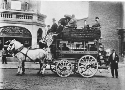 Omnibus, Upper Richmond Road, London, 1895: Aside from the adverts on the side of this 'bus, the most striking thing for me about this photograph is the state of the road - I doubt roads on construction sites are as bad as this these days. On the side of the bus, on the top board, can be seen an advert for Thomas Tilling. Thomas Tilling started business in 1846, buying horses and buses, along with the rights to operate certain London routes with them. By the mid 1850's he had 70 vehicles, and by the time of his death in 1893 he had a stable of some four thousand horses.