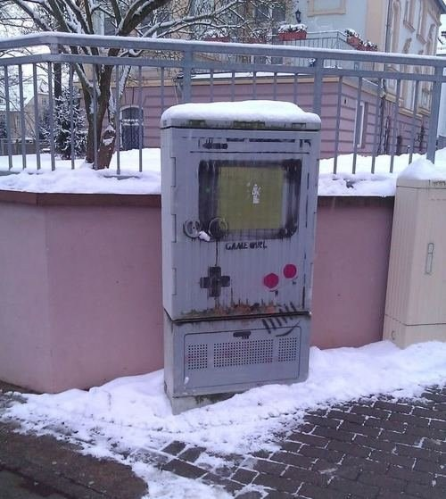 "thedailywhat:  Street Art of the Day  A pretty cool stencil art of Game Boy (or ""Game Girl"" it says) in Nordhausen, Germany.    U"