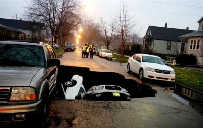 climateadaptation:  Sinkhole in Chicago neighborhood swallowed three cars this morning. As usual, this one was caused by a water main break. The water eroded the soil and rock under the road, creating a void and ultimate collapse. We'll hear a lot more of these incidences in the coming years. America's infrastructure is in rough shape, and water, sewer, and gas lines average close to 50 years old. Replacements costs are extremely high - most cities wait for a break to happen before replacing pipes, which is more expensive and dangerous over time. But, cities around the country are deferring maintenance due to a dwindling tax base. Via NBC.