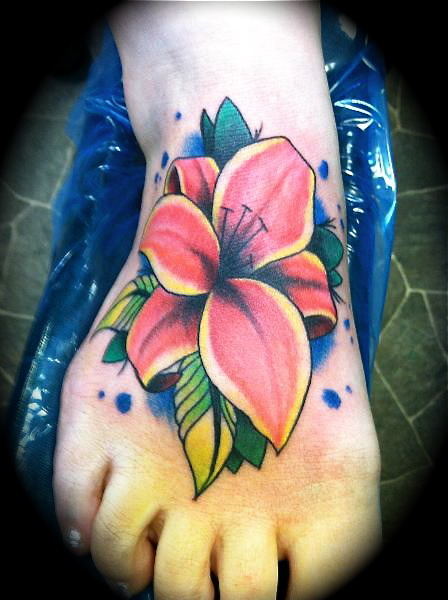 fuckyeahtattoos:  Traditional lily  Artist: Matt Aldridge- The Shop Tattoo and Piercing Studio, Bad Axe, MI