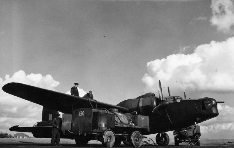 Vickers Wellington B Mark X of No. 83 Operational Training Unit, being refuelled from two petrol bowsers at Peplow, Shropshire. From HERE