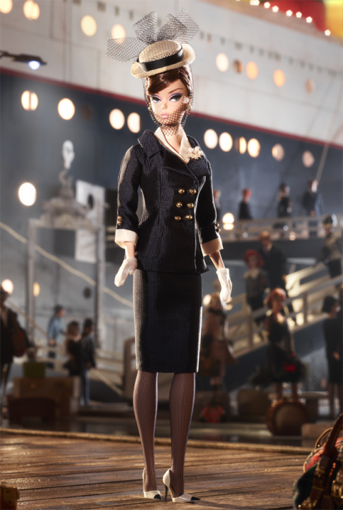 Boater EnsembleBarbie® Doll All aboard a fashion journey as Barbie® doll dresses in a beautifully tailored and flawlessly accessorized nautical outfit. Her sleeveless dress features a navy pencil skirt and off-white bodice covered with a double-breasted jacket with golden buttons. White gloves, spectator pumps, faux pearl earrings, a matching brooch and a charming boater hat complete the look.