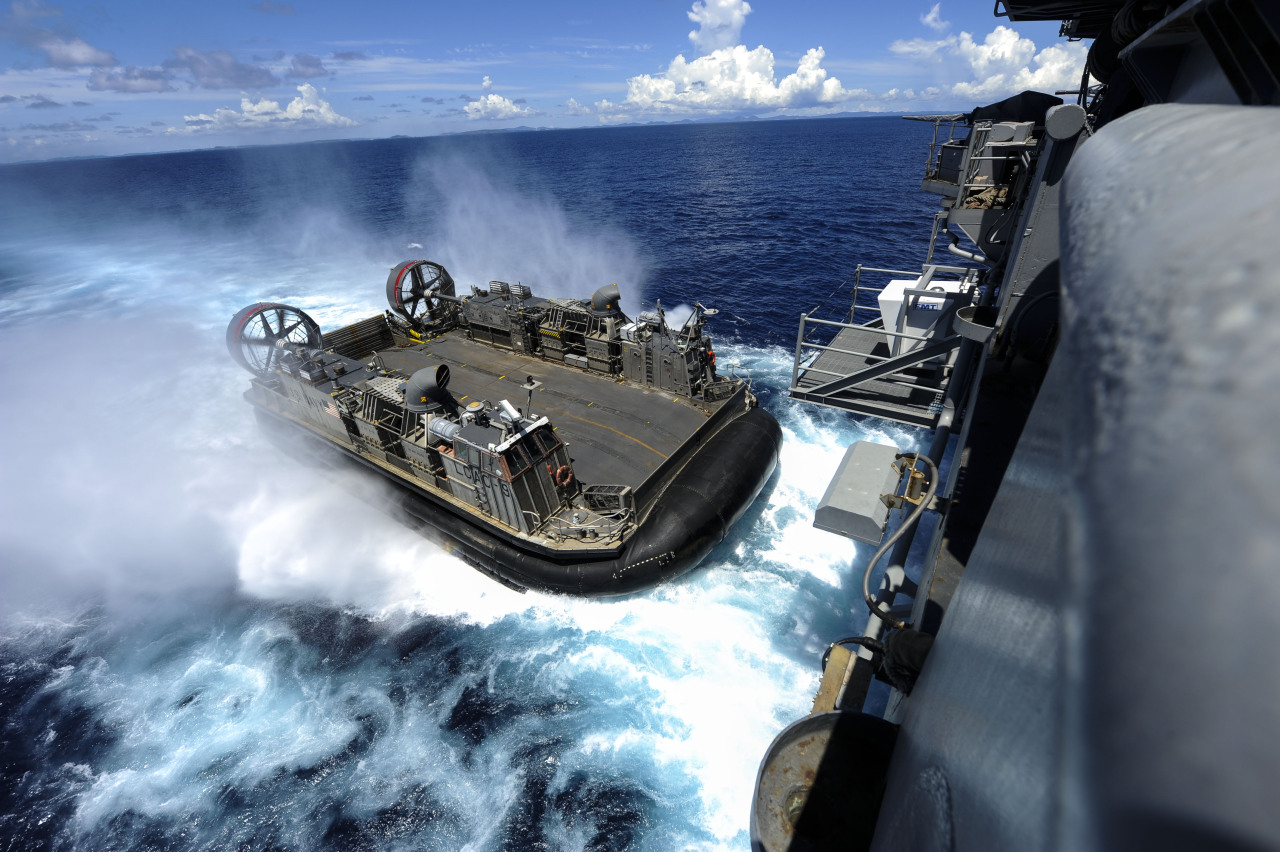 A landing craft air cushion (LCAC) enters the well deck of the forward-deployed amphibious assault ship USS Bonhomme Richard (LHD 6) to reload Marines and equipment for a certification exersize, Philippine Sea, September 2, 2012. Photo by Mass Communication Specialist 2nd Class Adam M. Bennett.