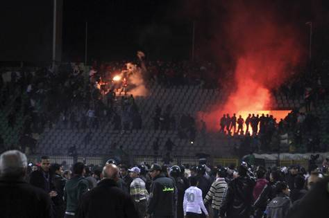 breakingnews:  Egypt soccer tragedy ruling prompts unrest on both sides Al Jazeera: An Egyptian court has upheld death sentences handed to 21 soccer fans for their role in a stadium riot in which more than 70 people were killed last year. The judge also acquitted seven of the nine police officers previously convicted over the disaster, which happened in the Suez city of Port Said at the end of a match between Cairo team Al-Ahly and local side Al-Masry. The verdict has prompted anger on both sides. Al-Ahly fans, whose number made up most of the dead, were angered at the the decision to acquit the police officers. They stormed the HQ of the Egypt soccer federation in Cairo, setting it alight. In Port Said, several hundred people, many of them relatives of the defendants, gathered outside the local government offices to vent their anger over the verdicts. Photo: A scene at the Port Said stadium disaster in February 2012. (Reuters)  The original verdict led to a series of violent riots in the country in January and February.