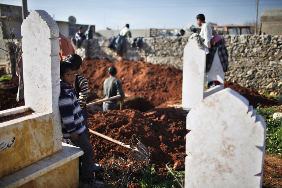 Dec. 30, 2012. A boy watches men dig graves for future casualties of Syria's civil conflict at Sheikh Saeed cemetery in Azaz city, north of Aleppo, Syria. (Ahmed Jadallah—Reuters) See more of the week's best images at TIME LightBox