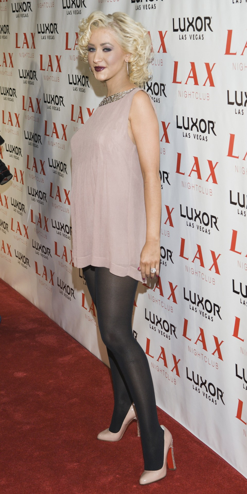 Christina Aguilera in a very short dress and hosiery!