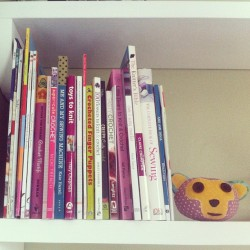 The collection of crochet and craft books is growing. Monkey made by @mrlizer is keeping guard.
