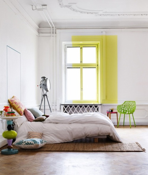 firsthome:  that big yellow color block is awesome, love the molding at the bottom of the wall, and i really want one of those searchlights