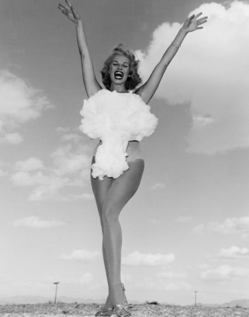"fyeah-history:  Miss Atomic Bomb, 1957""Copa Room showgirl Lee Merlin poses in a cotton mushroom cloud swimsuit as she is crowned Miss Atomic Bomb 1957 photograph. Above-ground nuclear testing was a major public attraction during the late 1950s, and hotels capitalized on the craze by hosting nuclear bomb watch parties, which usually included the dubbing of a chorus girl as Miss Atomic Bomb. Merlin was the last and most famous of the Miss Atomic Bomb girls"" - Las Vegas Sun"